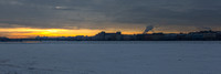A view of sunrise across the frozen Neva River